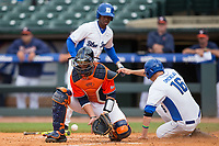 Virginia Cavaliers catcher Caleb Knight (5) waits for the throw as Michael Smiciklas (16) of the Duke Blue Devils slides across home plate in Game Seven of the 2017 ACC Baseball Championship at Louisville Slugger Field on May 25, 2017 in Louisville, Kentucky.  The Blue Devils defeated the Cavaliers 4-3 to advance to the Semi-Finals. (Brian Westerholt/Four Seam Images)