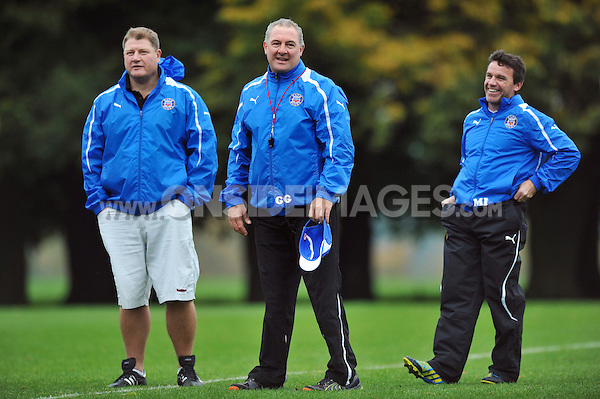 Forwards coach Neal Hatley, Head Coach Gary Gold and First team coach Mike Ford share a joke at the end of the session. Bath Rugby training session on October 25, 2012 at Farleigh House in Bath, England. Photo by: Patrick Khachfe/Onside Images