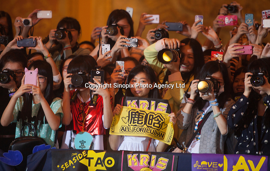 Fans of Korean boy band EXO-M, winner of the Most Influential Asian Group Award, itake photos of their idols at the 18th Channel [V] China Music Awards and Asian Influential Power Grand Ceremony at the Venetian Macau Casino in Macau, China, 23 April 2014