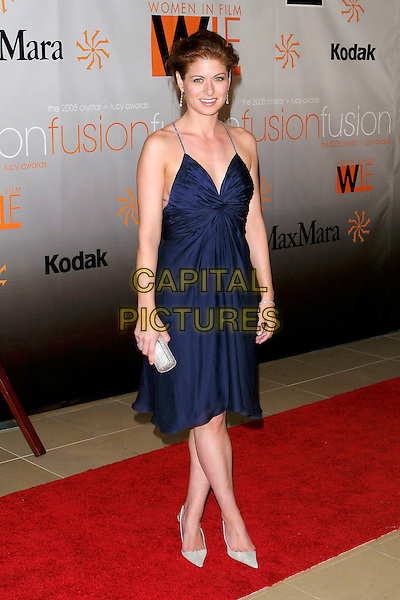 DEBRA MESSING.Women In Film presents Fusion, The 2005 Crystal and Lucy Awards An Evening Celebrating Partnership held at the Beverly Hilton, Beverly Hills, CA, USA, .10th June 2005..full length navy blue dress drop dangly earrings straps crystal diamante hand on hip clutch bag.Ref: ADM.www.capitalpictures.com.sales@capitalpictures.com.©Jacqui Wong/AdMedia/Capital Pictures.