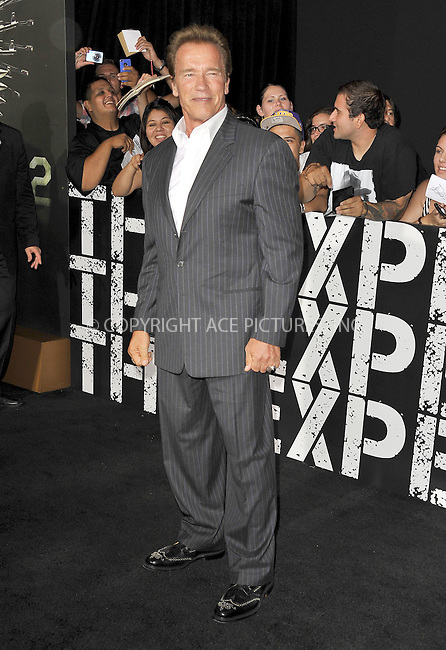WWW.ACEPIXS.COM......August 15, 2012, Los Angels, CA.......Arnold Schwarzenegger arriving at the Los Angeles Premiere of 'The Expendables 2' on August 15, 2012 in Hollywood, CA.......By Line: Peter West/ACE Pictures....ACE Pictures, Inc..Tel: 646 769 0430..Email: info@acepixs.com