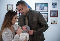 Army soldier father Jaden and wife with new born son stock photo DOD complient rights managed model released
