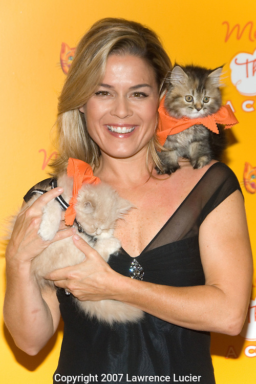 NEW YORK - AUGUST 20:  Iron Chef Cat Cora arrives at the Meow Mix Acatemy Orange Carpet Party August 20, 2007, at the Daryl Roth Theater in New York City.  (Photo by Lawrence Lucier)