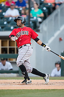 Elias Diaz (29) of the Indianapolis Indians follows through on his swing against the Charlotte Knights at BB&T BallPark on June 20, 2015 in Charlotte, North Carolina.  The Knights defeated the Indians 6-5 in 12 innings.  (Brian Westerholt/Four Seam Images)