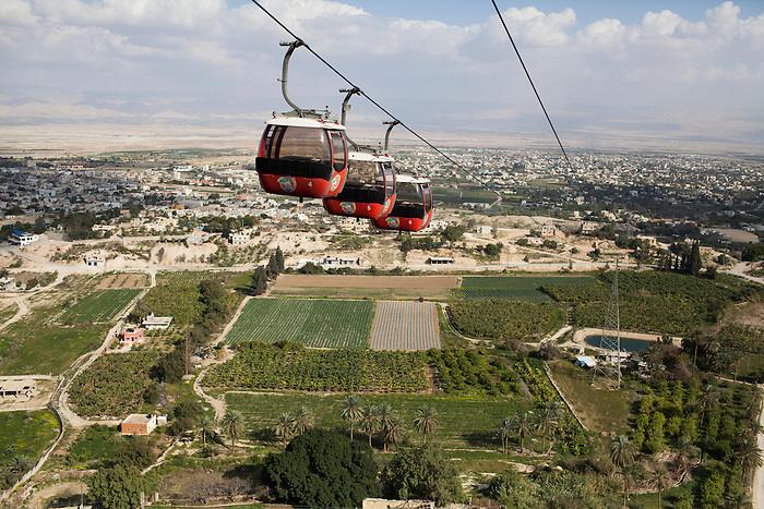 March 2013, Jericho. The cable cars leading to the temptation mount, used by the foreign tourist as much as by school trips. Jericho is the most fertile city in the West Bank and the only place in the Jordan Valley controlled by the Palestinian authority. The rest of the valley is controlled by Israel and many settlements in this area take control on the water resource at the expenses of the Palestinian farmers that find themselves obliged to buy their water to Israel: in average, Palestinians consume 10 times less water than their Israeli settlers counterparts, yet are obliged to pay ten times more.