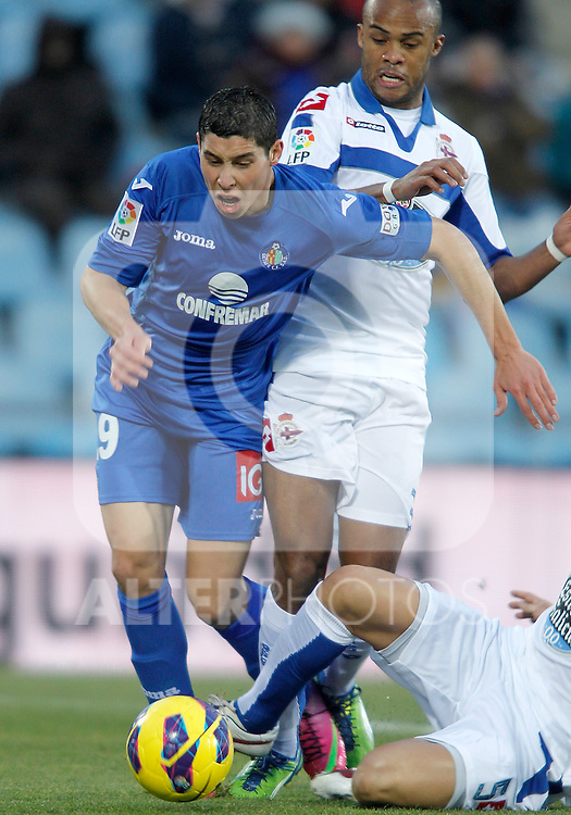 Getafe's Abdel Barrada against Deportivo de La Coruna's Evaldo Fabiano during La Liga match. February 01, 2013. (ALTERPHOTOS/Alvaro Hernandez)