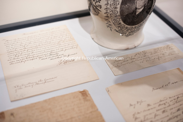 WATERBURY, CT-14 April 2015-041415EC06-  Some pieces in the Mattatuck Museum's Signature Moments: Historic Letters and Documents exhibit include a letter from Thomas Jefferson. The collection of historic signatures also includes letters from Benjamin Franklin, George Washington and P.T. Barnum. Erin Covey Republican-American