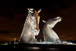 Designed by sculptor Andy Scott, The Kelpies in Falkirk are the world's largest equine sculptures and represent the lineage of the heavy horse of Scottish industry and economy, pulling the wagons, ploughs, barges and coalships that shaped the geographical layout of the Falkirk area.<br /> <br /> Pictured: The Kelpies at night<br /> <br /> Image by: Malcolm McCurrach<br /> Wed, 3, December, 2014 |  © Malcolm McCurrach 2014 |  Insertion and use fees apply |  All rights Reserved. picturedesk@nwimages.co.uk | www.nwimages.co.uk | 07743 719366
