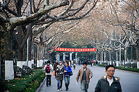 "Students walk along the main entrance to Nanjing University in Nanjing, Jiangsu, China.  Nanjing University is also know as Nan Da.  The red banner in the back bears a motivational motto in Mandarin Chinese that's translated loosely as ""Today, Nanjing University brings honor to me.  Tomorrow, I will bring honor to Nanjing University."""