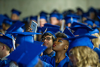 NWA Democrat-Gazette/ANTHONY REYES @NWATONYR<br />Tania Huggins takes a photo of the crowd of graduates Friday, May 19, 2017 for Rogers High School graduation at Bud Walton Arena in Fayetteville.