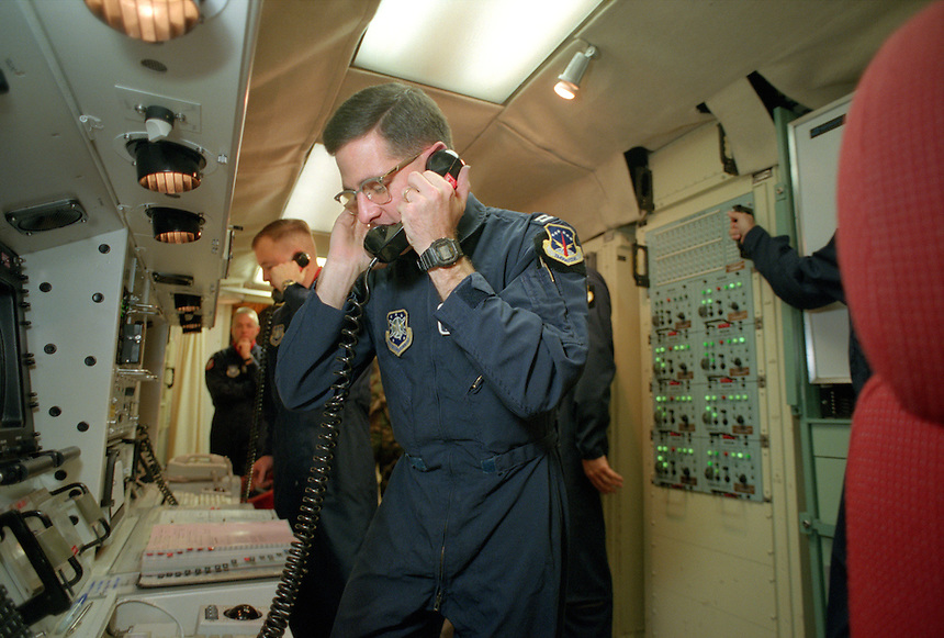 U.S. Air Force Capt. Dan Wetmore, right, and Lt. James Leighton scramble to double check the status of equipment and missiles after power was cut to their missile launch facility in eastern Wyoming by service contractors. The facility has both batteries and generators as backup power supply sources for events as common as this and as threatening as a nuclear war. Nuclear missile crews still stand at the ready with hundreds of silos across the plains of the West.