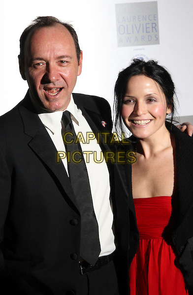 KEVIN SPACEY & ANDREA CORR .Laurence Olivier Awards at the Grosvenor House Hotel, Park Lane, London, England, March 8th 2009.half length black tie white shirt suit red .CAP/JIL.©Jill Mayhew/Capital Pictures