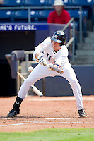 Dominic Ficociello #32 (Arkansas) of the USA Baseball Collegiate National Team lays down a bunt against the Japan Collegiate National Team at the Durham Bulls Athletic Park on July 3, 2011 in Durham, North Carolina.  USA defeated Japan 7-6.  (Brian Westerholt / Four Seam Images)