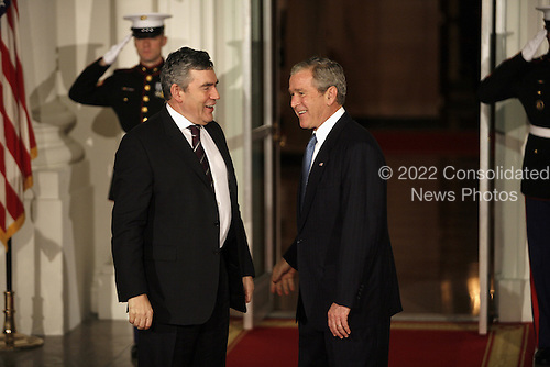 Washington, DC - November 14, 2008 -- United States President George W. Bush greets Gordon Brown, Prime Minister of the United Kingdom to the White House for a working dinner at the start of the G20 Summit on Financial Markets and the World Economy.Credit: Gary Fabiano - Pool via CNP