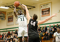 Memorial's Yacouba Traore Jr. takes a jump shot over Middleton's Billy Johnson in the first period, as Middleton takes on Madison Memorial in Wisconsin Big Eight Conference boys basketball on Friday, 12/20/19 at James Madison Memorial High School in Madison