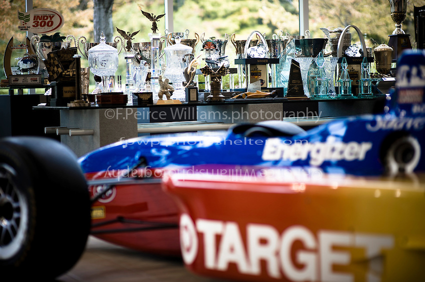 Trophies won by Target Chip Ganassi Racing on display in the lobby and a ChampCar.