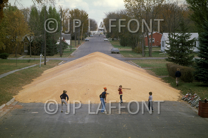 Bufalo Lake, MN. October 26th, 1978. <br /> Agriculture - wheat harvest are being stocked in the streets. The sillos are full.
