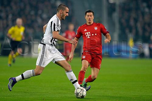 23.02.2016. Turin, Italy. UEFA Champions League football. Juventus versus Bayern Munich.  Leonardo Bonucci plays the ball as Robert Lewandowski covers