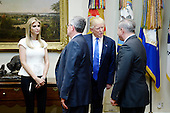 United States President Donald Trump and daughter Ivanka Trump greet participants including Brian A. Gallagher ,President and Chief Executive Officer of United Way Worldwide (L) and John Richmond (R) ,a federal prosecutor serving as the Special Litigation Counsel with the U.S. Department of Justice's Human Trafficking Prosecution Unit before a listening session on domestic and international human trafficking in the Roosevelt Room of the White House on February 23, 2017 in Washington, DC. <br /> Credit: Olivier Douliery / Pool via CNP