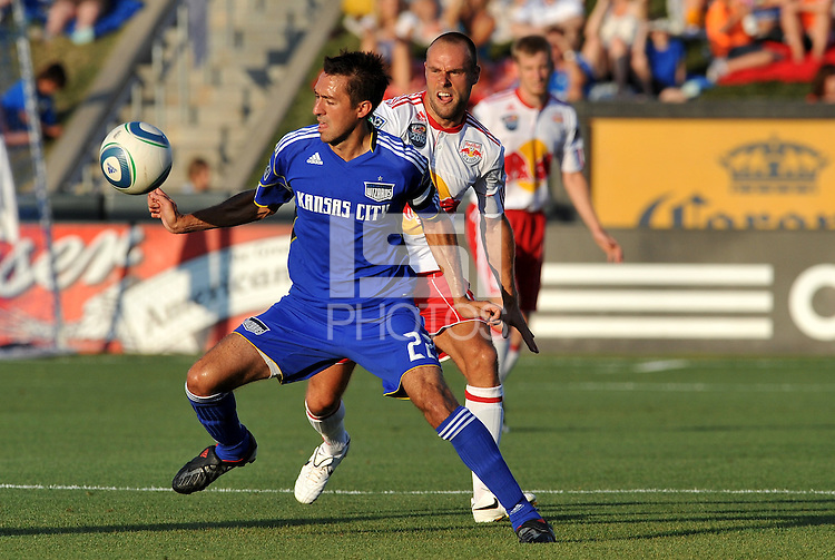 Davy Arnaud (blue), Joel Lindpere...Kansas City Wizards were defeated 3-0 by New York Red Bulls at Community America Ballpark, Kansas City, Kansas.