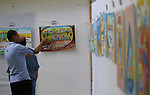 "Palestinians attend the art exhibition ""draw your dream for Gaza 2020"", in Gaza city on Aug. 23, 2016. Photo by Mohammed Asad"