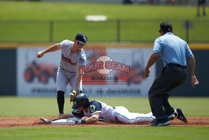 Drew Waters (11) of the Gwinnett Stripers slides into second base ahead of the tag by Mandy Alvarez (24) of the Scranton/Wilkes-Barre RailRiders as umpire Charlie Ramos looks on at Coolray Field on August 18, 2019 in Lawrenceville, Georgia. The RailRiders defeated the Stripers 9-3. (Brian Westerholt/Four Seam Images)