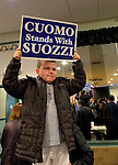 Albertson, New York, U.S. 26th October 2013. THOMAS BIAMONTE, 8, of Oceanside, stands high holding a poster when New York Governor Cuomo endorses Suozzi for Nassau County Executive, at the Albertson Veterans of Foreign Wars VFW Post. Democrat Suozzi, the former Nassau County Executive, and Republican incumbent Mangano face each other in a rematch in the upcoming November 5th election.