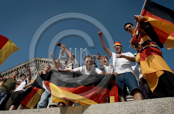 """BERLIN - GERMANY 20. JUNE 2006 -- FIFA World Cup 2006 - Germany - Ecuador 3-0 - German football fans celebrating the result in front of the Reichtag -- PHOTO: CHRISTIAN T. JOERGENSEN /  EUP & IMAGES..This image is delivered according to terms set out in """"Terms - Prices & Terms"""". (Please see www.eup-images.com for more details)"""