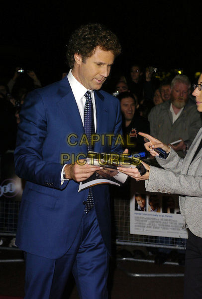 "WILL FERRELL.Attends The Times BFI London Film Festival: ""Stranger Than Fiction"" Gala Screening, held at the Odeon West End Cinema, London, England, October 20th 2006..half length signing autographs blue suit.Ref: CAN.www.capitalpictures.com.sales@capitalpictures.com.©Can Nguyen/Capital Pictures"