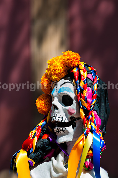 A decorated skeleton figurine is seen at the altar of the dead (altar de muertos), a religious site honoring the deceased, during the Day of the Dead festivities in Morelia, Michoacán, Mexico, 3 November 2014. Day of the Dead ('Día de Muertos') is a syncretic religious holiday, celebrated throughout Mexico, combining the death veneration rituals of the ancient Aztec culture with the Catholic practice. Based on the belief that the souls of the departed may come back to this world on that day, people gather on the gravesites praying, drinking and playing music, to joyfully remember friends or family members who have died and to support their souls on the spiritual journey.