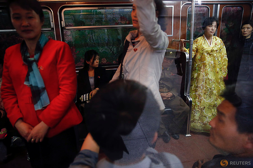 Passengers travel on a train departing the station visited by foreign reporters on a government organised tour in central Pyongyang, North Korea May 7, 2016.  REUTERS/Damir Sagolj