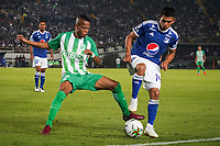 BOGOTA - COLOMBIA, 11-01-2019: David MacCalister Silva (Der.) jugador de Millonarios disputa el balón con Jean Lucas Rivera (Izq.) jugador de Atlético Nacional, durante partido entre Millonarios y Atlético Nacional, por el Torneo Fox Sports 2019, jugado en el estadio Nemesio Camacho El Campin de la ciudad de Bogotá. / David MacCalister Silva (R) player of Millonarios vies for the ball with Jean Lucas Rivera (L) during a match between Millonarios y Atletico Nacional, for the Fox Sports Tournament 2019, played at the Nemesio Camacho El Campin stadium in the city of Bogota. Photo: VizzorImage / Diego Cuevas / Cont.