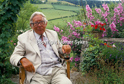 Laurie Lee author in the garden of his home Slad near Stroud Gloucestershire