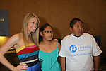 Kim Matula and child with new hearing aid at the Starkey Hearing Foundation event on June 18, 2011 at the Las Vegas Hilton, Las Vegas, Nevada. (Photo by Sue Coflin/Max Photos)