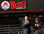 December 27, 2011, Tokyo, Japan - U.S. Ambassador to Japan John Roos takes a bite out of a Wendy's hamburger during a re-launchi celebration of its fast-food restaurant in Tokyo on Tuesday, December 27, 2011. At right is his wife. In December 2009, Wendys did not renew its franchise agreement with its former franchisee for Japan, resulting in the closure of 71 restaurants. Wendys and Higa Industries, a successful food importer and distributor based in Tokyo, signed a joint venture agreement to develop and operate Wendys restaurants in Japan. Wendys Japan plans to open 100 stores in the next five years. (Photo by Natsuki Sakai/AFLO) [3615] -mis-
