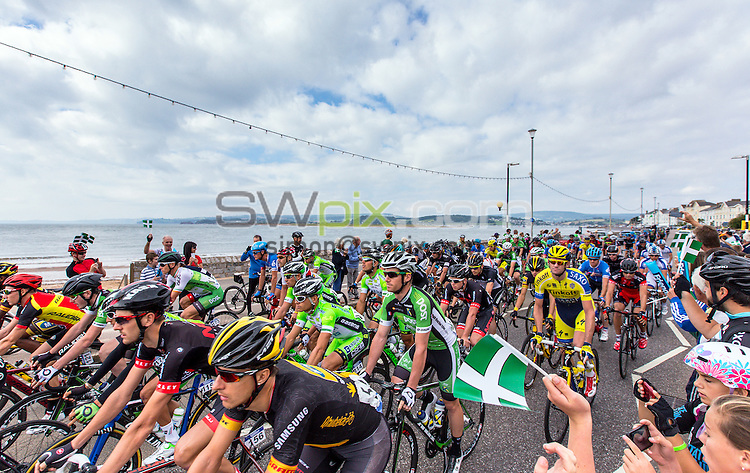 Picture by Alex Whitehead/SWpix.com - 11/09/2014 - Cycling - 2014 Friends Life Tour of Britain - Stage 5, Exmouth to Exeter - The riders roll out of Exmouth at the start of stage 5.