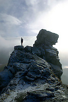 A walker on the summit of The Cobbler (Ben Arthur) above Arrochar, Arrochar Alps, Loch Lomond and the Trossachs National Park, Argyll & Bute<br /> <br /> Copyright www.scottishhorizons.co.uk/Keith Fergus 2011 All Rights Reserved