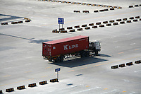 A truck enters the Yangshan Deep Water Port near Shanghai, China..11 Feb 2007