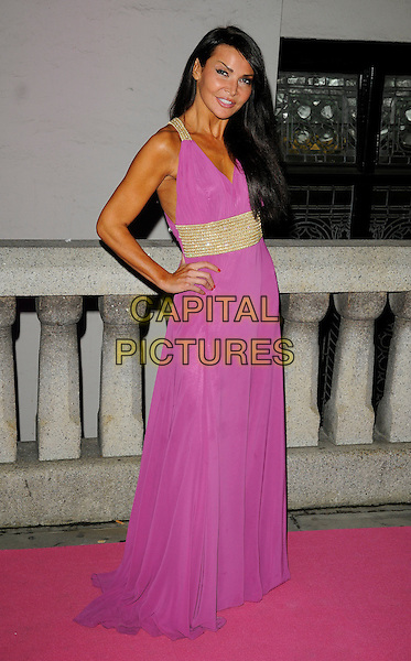 LIZZIE CUNDY.The Inspiration Awards For Women at the Cadogan Hall, London, England, UK..October 6th 2010 .full length pink purple dress maxi hand on hip gold tanned liz maxi dress .CAP/CAN.©Can Nguyen/Capital Pictures.