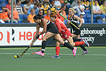The Hague, Netherlands, June 02: Kayla Whitelock #1 of New Zealand defends the ball against Eunbi Cheon #32 of Korea during the field hockey group match (Group A) between Korea and New Zealand´s Black Sticks on June 2, 2014 during the World Cup 2014 at GreenFields Stadium in The Hague, Netherlands. Final score 1:0 (1:0) (Photo by Dirk Markgraf / www.265-images.com) *** Local caption ***