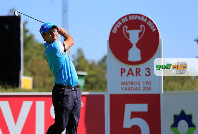 Edoardo Molinari (ITA) tees off the par3 5th tee during Thursday's Round 1 of the 2014 Open de Espana held at the PGA Catalunya Resort, Girona, Spain. Wednesday 15th May 2014.<br /> Picture: Eoin Clarke www.golffile.ie
