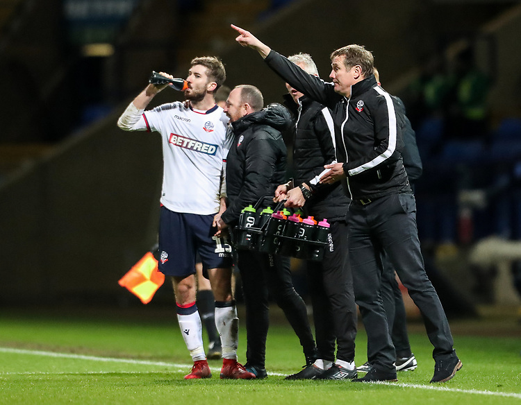Bolton Wanderers' manager Phil Parkinson issues instructions as Luke Murphy takes refreshment<br /> <br /> Photographer Andrew Kearns/CameraSport<br /> <br /> Emirates FA Cup Third Round - Bolton Wanderers v Walsall - Saturday 5th January 2019 - University of Bolton Stadium - Bolton<br />  <br /> World Copyright © 2019 CameraSport. All rights reserved. 43 Linden Ave. Countesthorpe. Leicester. England. LE8 5PG - Tel: +44 (0) 116 277 4147 - admin@camerasport.com - www.camerasport.com