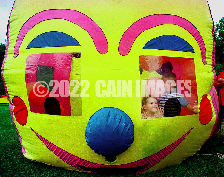 Gabby Palmieri, 2, and her brother Ronnie, both of Morrisville, Pa., play inside a Balloon Typhoon during the annual Labor Day picnic, Sept. 1, 1997, in Morrisville, Pa. (Photo by William Thomas Cain)