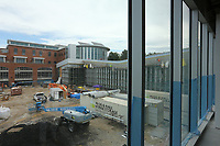 David Johnson, executive director of the Fayetteville Public Library, and Roxi Hazelwood, development and sponsorship coordinator with the Fayetteville Public Library Foundation, give a tour Thursday, July 30, 2020, of the new expansion area of the library still under construction. The new addition of 82,500-square-feet will nearly double the size of the 88,000-square-foot main library. Check out nwaonline.com/200802Daily/ and nwadg.com/photos for a photo gallery.<br /> (NWA Democrat-Gazette/David Gottschalk)<br /> <br /> FZ LIBRARY 8-2