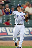 Round Rock Express third baseman Alex Buchholz (5) makes a throw to first base against the Oklahoma City RedHawks during the Pacific Coast League baseball game on August 25, 2013 at the Dell Diamond in Round Rock, Texas. Round Rock defeated Oklahoma City 9-2. (Andrew Woolley/Four Seam Images)