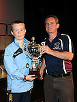 Drogheda and District Schoolboys league representative Keith Wallace presents Drogheda Marsh Crescent under 14 captain Leon Campbell with the Divisoin 1 cup. Photo:Colin Bell/pressphotos.ie