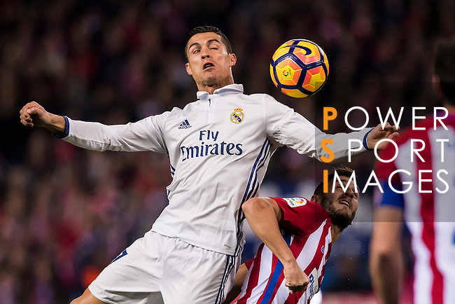 Cristiano Ronaldo of Real Madrid fights for the ball with Koke of Atletico de Madrid during their La Liga match between Atletico de Madrid and Real Madrid at the Vicente Calderón Stadium on 19 November 2016 in Madrid, Spain. Photo by Diego Gonzalez Souto / Power Sport Images
