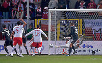 Carlos Bocanegra (3) of the USA scores the opening goal of the game past a diving Artur Boruc (1) of Poland. The United States defeated Poland 3-0 during an international friendly at Wisla Stadium in Krakow, Poland on March 26, 2008.