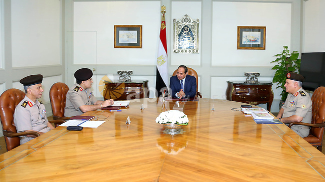 Egyptian President Abdel Fattah al-Sisi meets with Defense Minister Advisor, in Cairo on November 8, 2015. Photo by Egyptian President Office