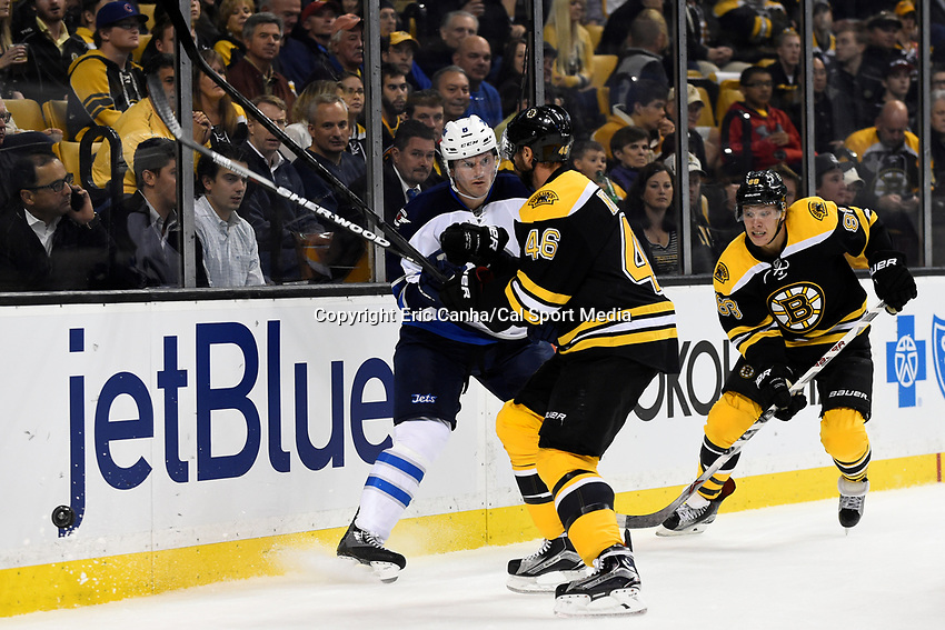 Thursday, October 8, 2015: Winnipeg Jets defenseman Jacob Trouba (8) braces for a hit from Boston Bruins center David Krejci (46) during the NHL game between the Winnipeg Jets and the Boston Bruins held at TD Garden, in Boston, Massachusetts. Winnipeg defeated Boston 6-2 in regulation time. Eric Canha/CSM